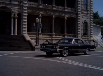 The Merc in front of 5-O HQ, the 'Iolani Palace