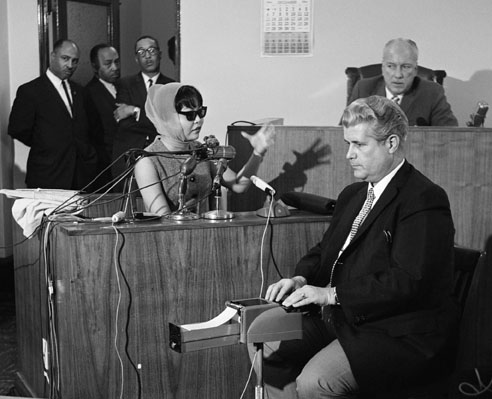 16 Dec 1964, Los Angeles, California, USA --- Witness Elisa Boyer, wearing a disguise, testifies during the Coroner's Inquest of the murder of soul singer Sam Cooke. --- Image by © Bettmann/CORBIS
